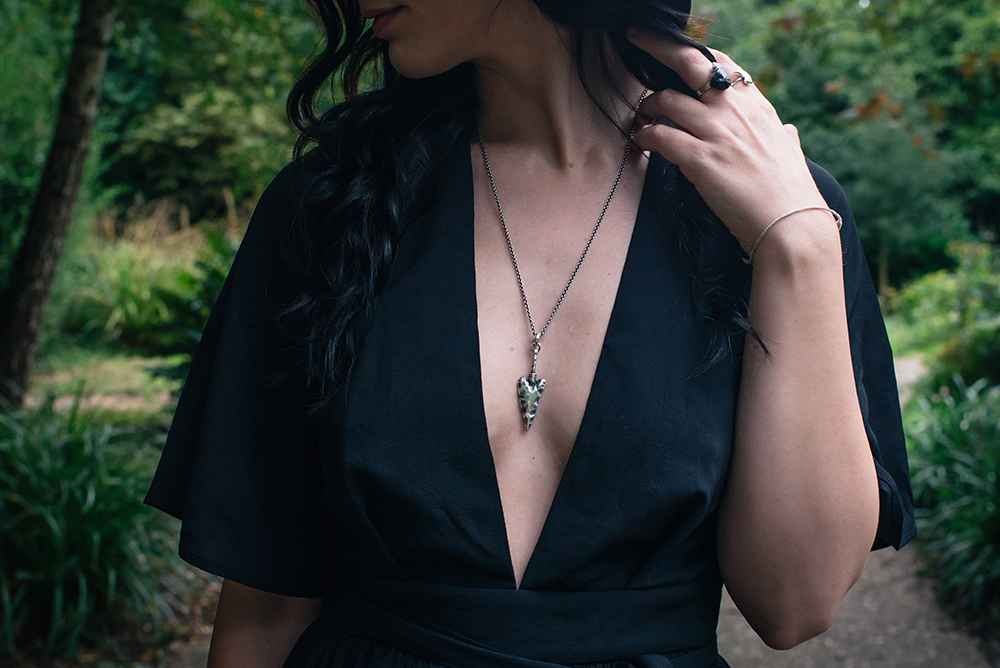 Fashion blogger Stephanie of FAIIINT wearing Toilworn jewellery silver arrowhead necklace and Elemental Luxury quartz ring. Witchy outfit details.