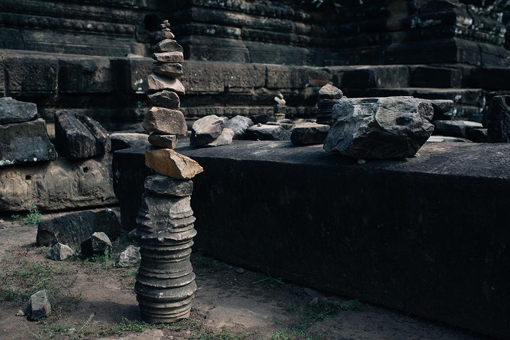 Bayon temple ruins Siem Reap Angkor Cambodia, stacking stones.