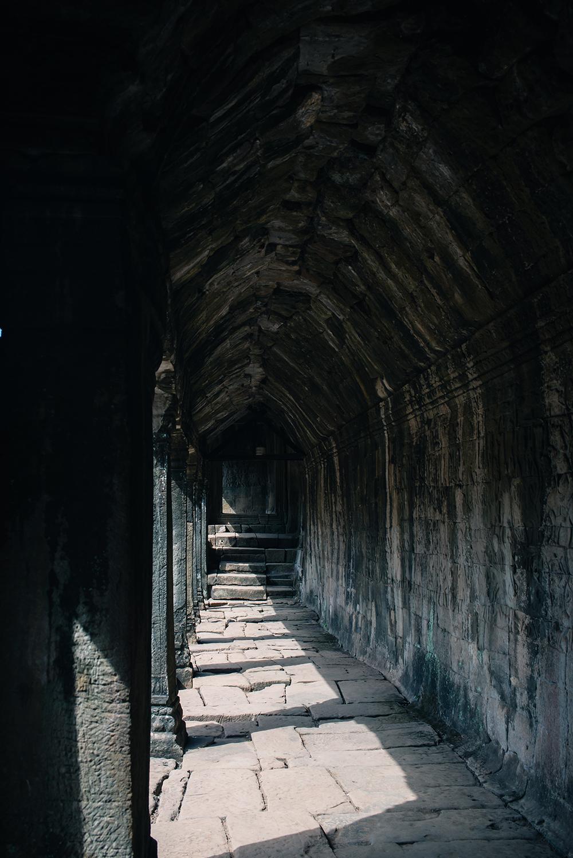 Bayon temple ruins Siem Reap Angkor Cambodia, corridor with sunlight.
