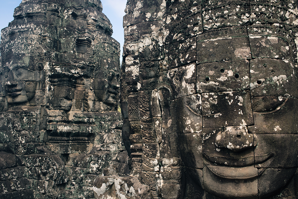 Bayon temple ruins Siem Reap Angkor Cambodia, faces sculptures.