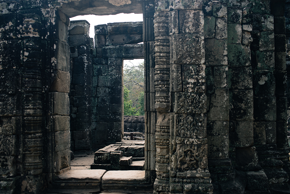 Bayon temple ruins Siem Reap Angkor Cambodia, room with no roof and detail carvings.