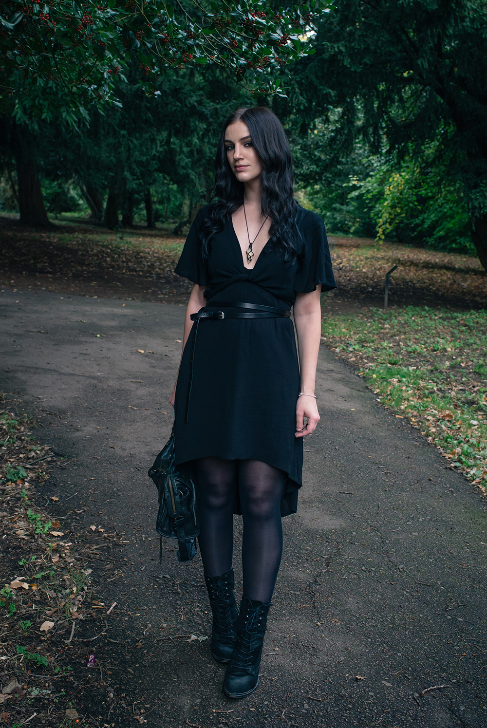 Fashion blogger Stephanie of FAIIINT wearing Tobi high low dress with cropped kimono wrap top, All Saints double belt, Quartz necklace, Kurt Geiger Saturn lace up boots. All black dark street style outfit.