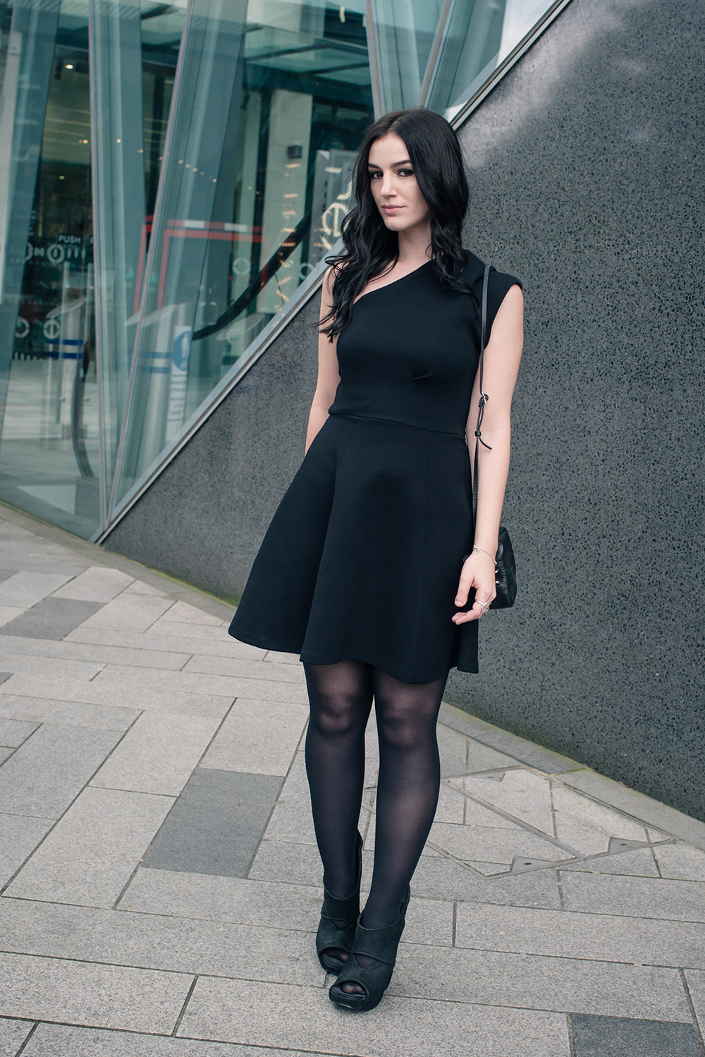 Fashion blogger Stephanie of FAIIINT wearing Reiss one shoulder asymmetric Keria dress with Rick Owens wave wedge shoes. All black outfit.