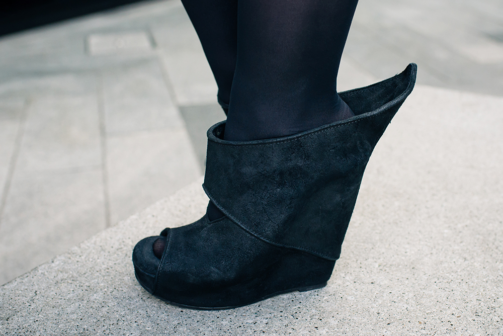 Fashion blogger Stephanie of FAIIINT wearing Rick Owens wave black suede peak back wedge shoes.