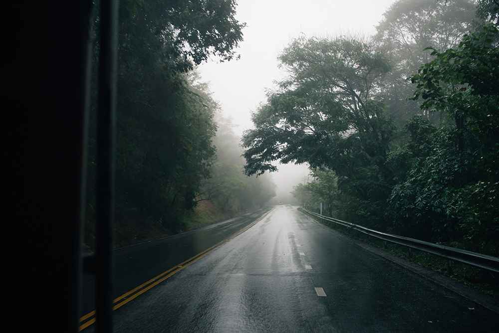 Misty mountain road up to Wat Phra That Doi Suthep Chiang Mai Thailand.