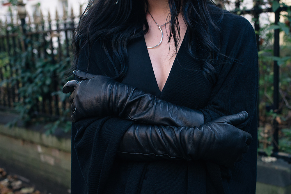 Fashion blogger Stephanie of FAIIINT wearing Black elbow length leather gloves and black cape. Outfit details.