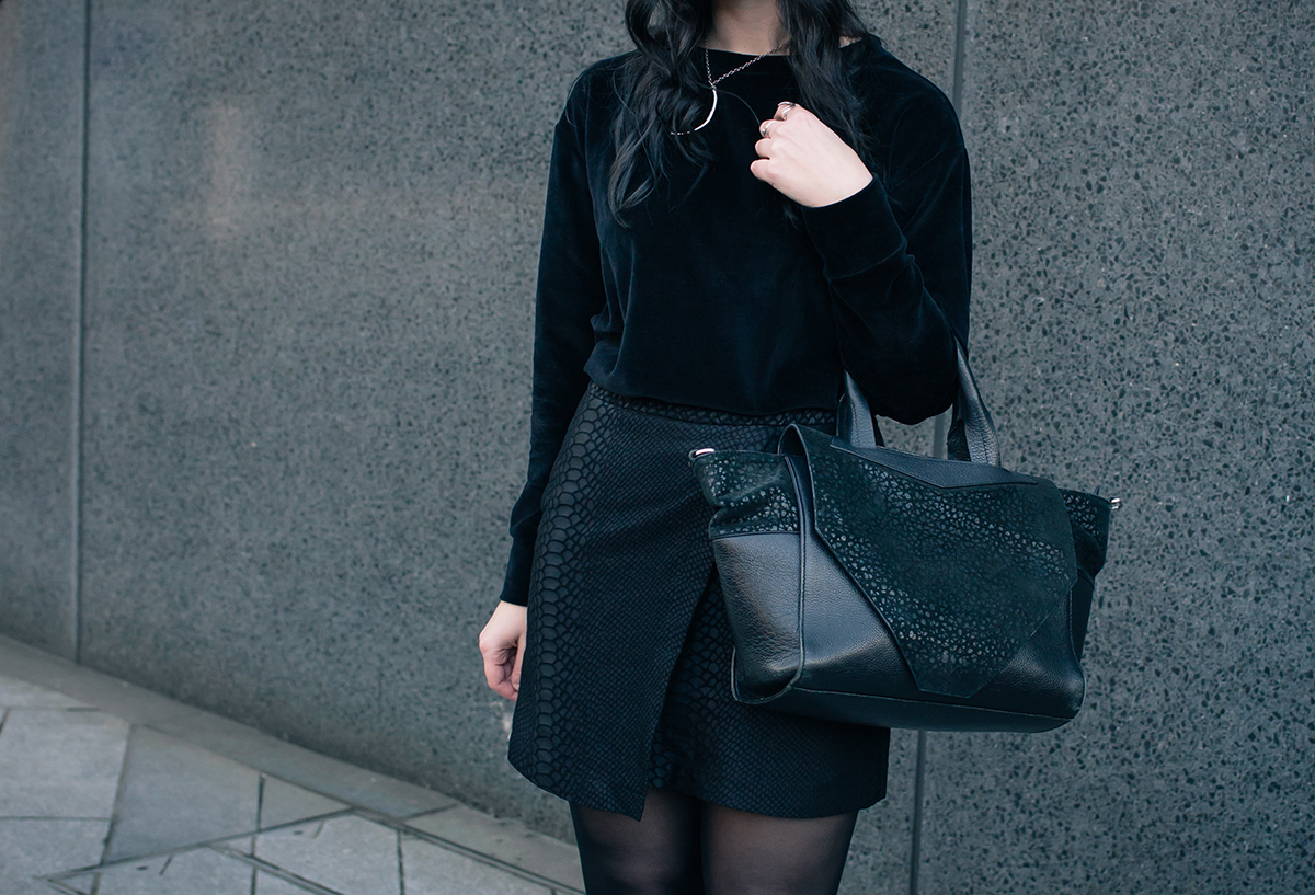 Fashion blogger Stephanie FAIIINT wearing Le Tee Paris velvet sweatshirt, Topshop snake textured skirt, Birds n Bones silver claw ring, Le Lou Ula Theurgy ring. All black outfit details.