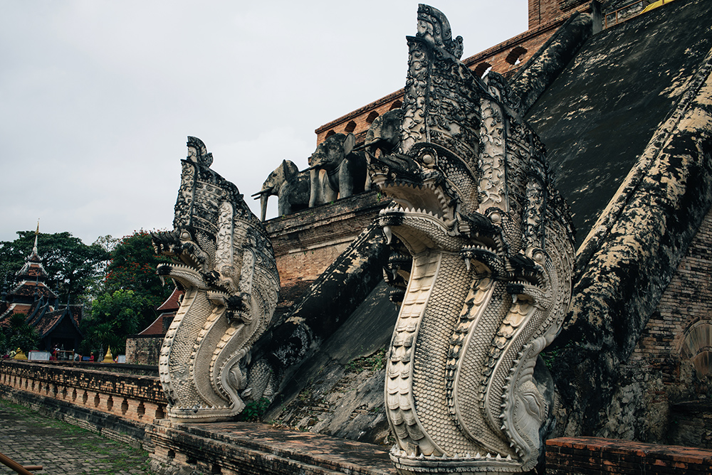 Wat Chedi Luang temple dragon statues, Chiang Mai Thailand.