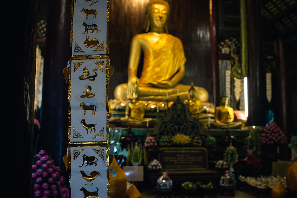 Wat Phan Tao wooden temple with golden Buddha Chiang Mai Thailand.