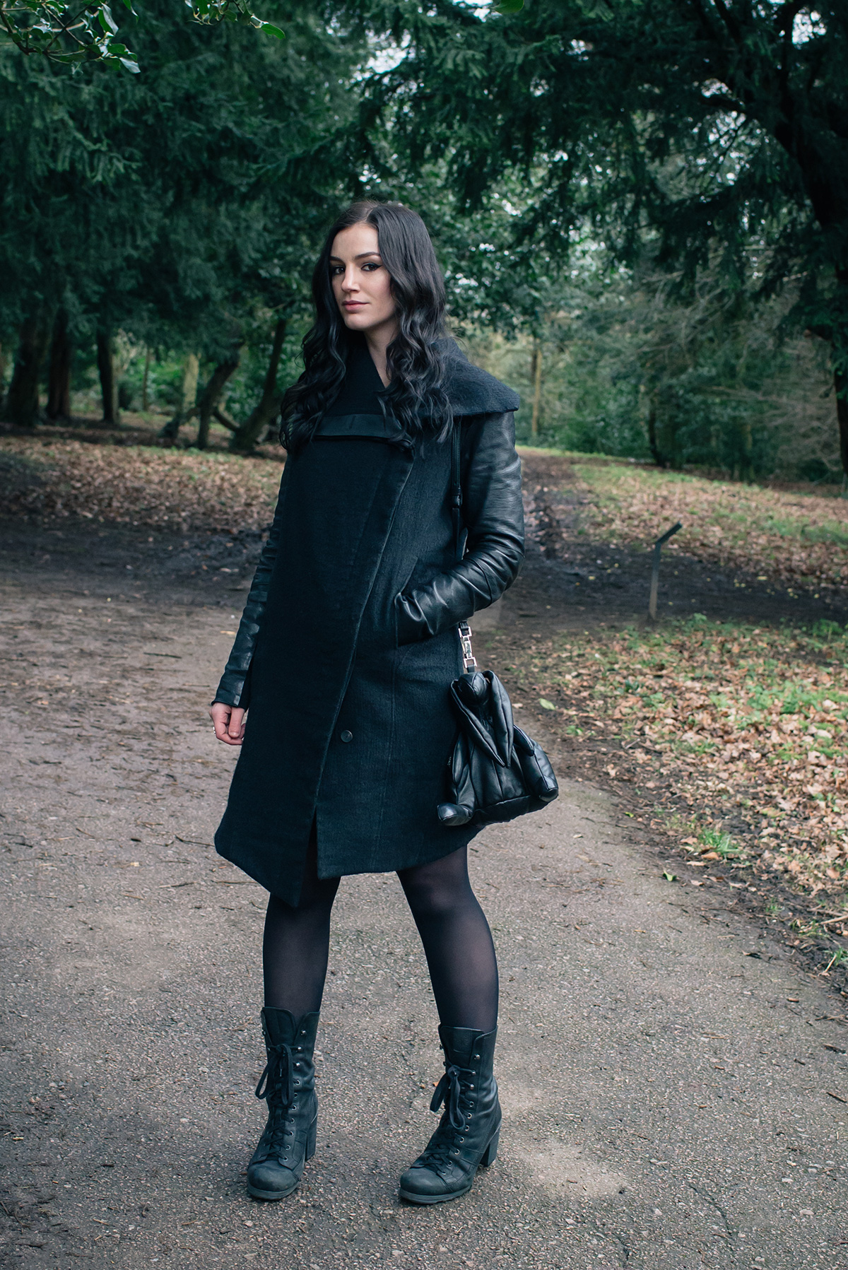 Fashion blogger Stephanie of FAIIINT wearing Helmut Lang Willowed wool and leather asymmetric coat, O.X.S. lace up boots, Christopher Raeburn Hare bag. All black dark style outfit.