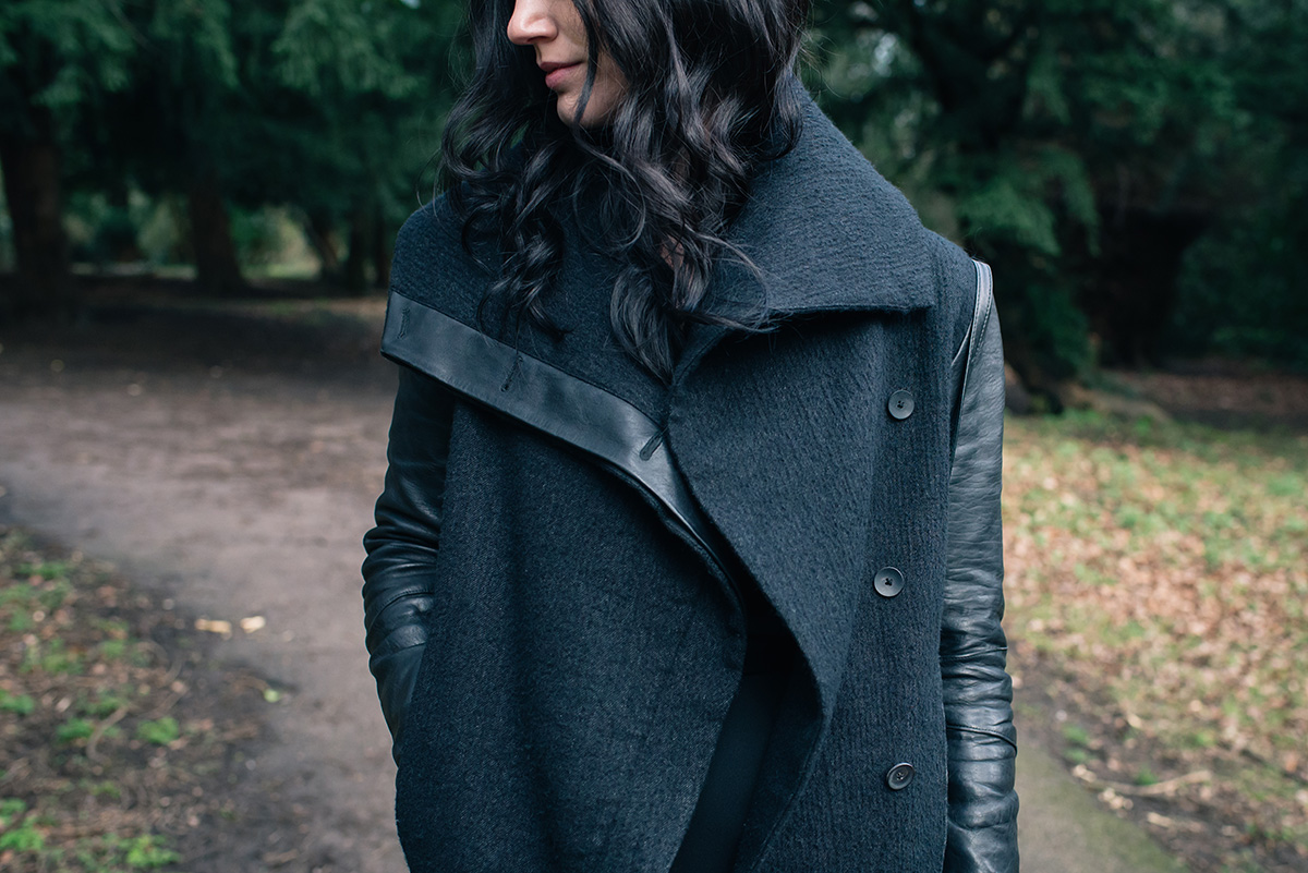 Fashion blogger Stephanie of FAIIINT wearing Helmut Lang Willowed wool and leather asymmetric coat. All black outfit details.