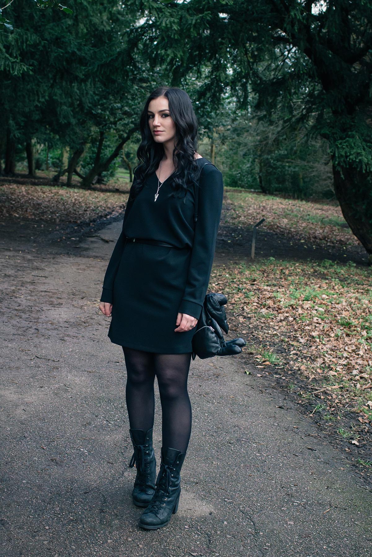 Fashion blogger Stephanie of FAIIINT wearing Le Tee Paris little black shift dress, O.X.S. lace up boots, Christopher Raeburn Hare bag. All black dark style outfit.