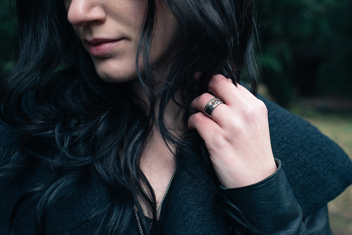 Fashion blogger Stephanie of FAIIINT wearing Velvet Aether blanket of ash silver ring. Dark style outfit details.