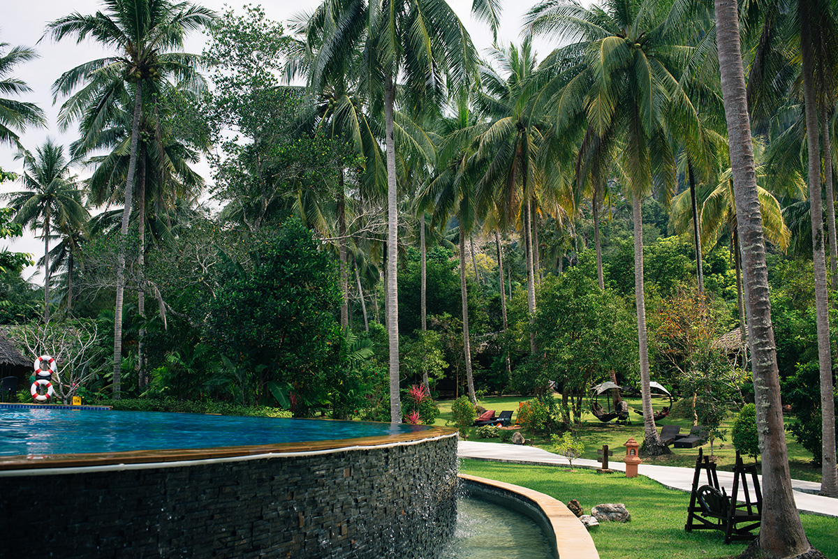 Ban Sainai Resort pool and palm trees Ao Nang Krabi Thailand