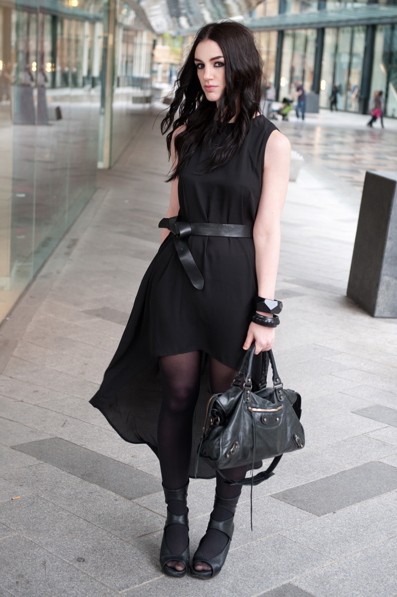 Fashion Blogger FAIIINT wearing Glamorous dip hem dress from MeeMee, H&M Knotted Belt, ASOS & Angie Gooderham bangles, Rick Owens wedges, balenciaga city, street style all black