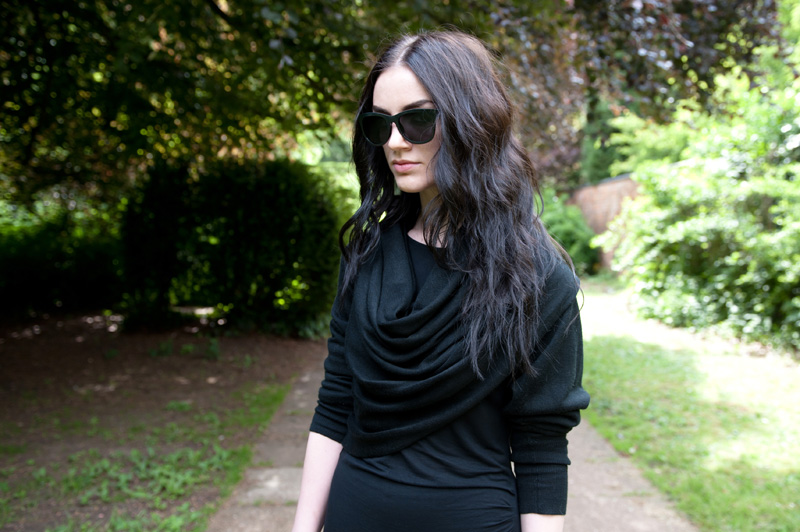Fashion blogger Stephanie Brown FAIIINT wearing Staple the label wrapped cardigan, Full Circle Dress, StylistPick Avery studded sneakers trainers, Le Specs 'Revolver' Sunglasses from Sunglasses Shop, Balenciaga City bag. Casual all black, dark style outfit.