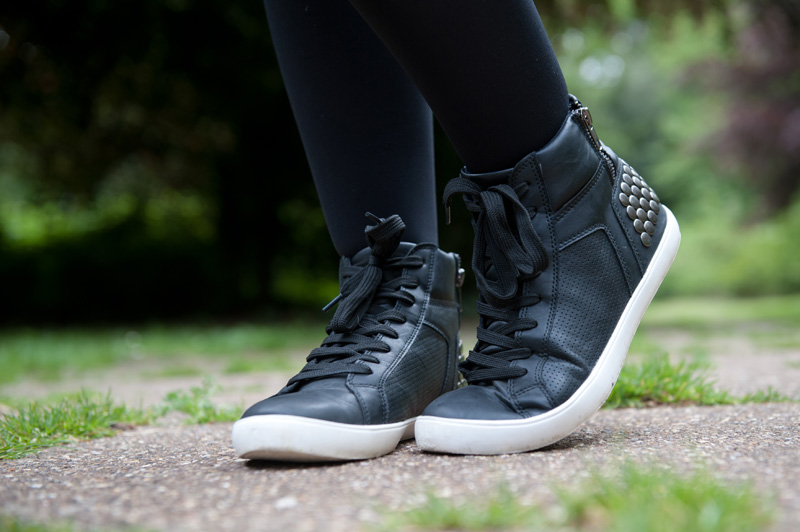 Fashion blogger Stephanie Brown FAIIINT wearing StylistPick Avery black, white & silver studded sneakers trainers
